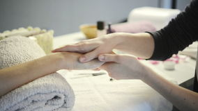 Manicure and applying hand moisturizer stock footage