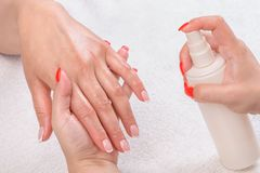 Manicure applying - moisturising Royalty Free Stock Photos