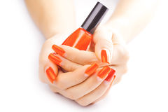 Manicure. applying red nail polish. isolated Stock Image