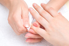 Manicure applying - wiping the moisturizer Royalty Free Stock Images
