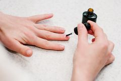 Manicure arms. Nail primer during the procedure nail gel. Nail primer during the procedure nail gel Stock Photos