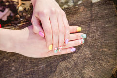 Manicure on a background of cut wood Royalty Free Stock Images