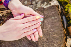 Manicure on a background of cut wood Royalty Free Stock Image