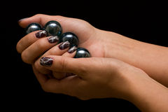Manicure with balls Stock Images