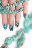 Manicure with beads and turquoise. Royalty Free Stock Image