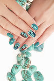 Manicure with beads and turquoise. Stock Photos