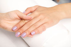 Manicure - Beautiful manicured woman's nails with violet nail po Stock Image