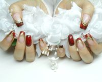 Nail designs: beautiful red roses, gold and craquelure royalty free stock photo