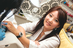 Manicure 2. Beautiful young woman doing manicure in the salon Stock Photos