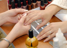 A manicure is in a beauty salon. Of spa Stock Images