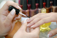 A manicure is in a beauty salon
