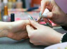 Manicure in beauty salon. Applying manicure in beauty salon Royalty Free Stock Photo