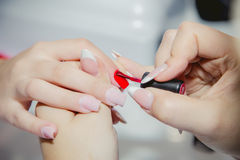 Manicure in a beauty salon, master class Royalty Free Stock Photo