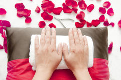 Manicure in a beauty salon - woman palms ready for treatment. Manicure in a beauty salon - woman palms lying on pillow and towels ready for treatment Stock Image