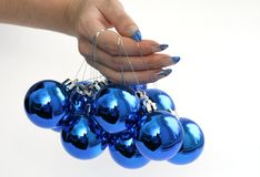 Manicure and blue balls Royalty Free Stock Image