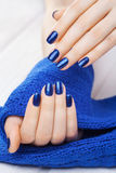 Manicure with blue knitted scarf Royalty Free Stock Images