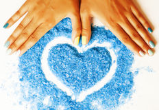 Manicure with blue nails and seasalt Royalty Free Stock Image