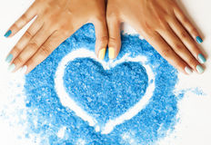 Manicure with blue nails and seasalt close up like. Heart,  in love for summer Stock Photography