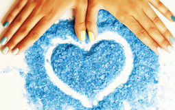 Manicure with blue nails and seasalt. Close up like heart, love for summer Royalty Free Stock Image