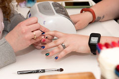 Manicure. With blue polish close up on hands Royalty Free Stock Image