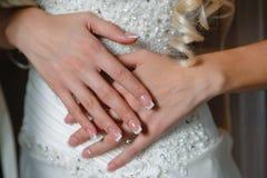 Manicure bride on background of wedding dress Stock Photo