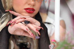 Manicure of bride wearing black net gloves Royalty Free Stock Photography