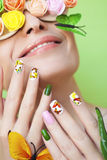 Manicure with butterflies. Stock Image