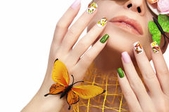 Manicure with butterflies. Royalty Free Stock Photography