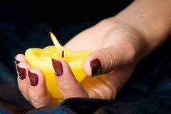 Manicure with candle stock photo