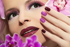 Manicure con l'orchidea Fotografia Stock