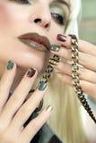 Manicure con la catena Fotografie Stock
