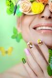 Manicure con le farfalle Immagine Stock