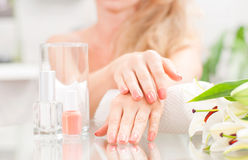 Manicure concept. Beautiful woman& x27;s hands with perfect manicure at beauty salon. stock image