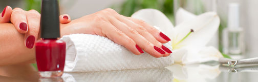 Manicure concept. Beautiful woman& x27;s hands with perfect manicure at beauty salon. stock photography