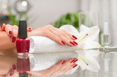 Manicure concept. Beautiful woman& x27;s hands with perfect manicure at beauty salon. stock images