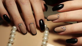 Manicure design, black and coffee with rhinestones Royalty Free Stock Photos