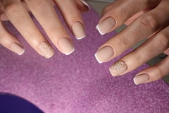 Manicure design for the bride French. Manicure design nails for the bride French royalty free stock photography