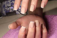 Manicure design for the bride French. Manicure design nails for the bride French royalty free stock image