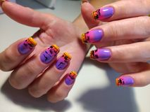 manicure design on the nails African sunset stock image