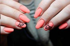 Manicure design orange geometry. Nails stock photography