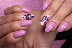 Manicure design purple with flower stock photo