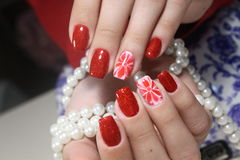 Manicure design Red flowers nails stock image
