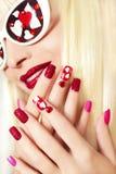 Manicure e trucco con i cuori Fotografia Stock Libera da Diritti