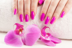 Beautyful manicure with fragrant orchid and towel. Royalty Free Stock Photos