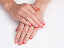 Manicure francese con le punte arancioni Immagine Stock Libera da Diritti