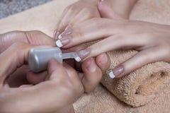 manicure gör för att spika upp polerade produkter Arkivbild