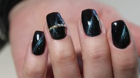 Manicure gel with cat eye. Beautiful manicure gel with cat lacquer eye Stock Photos