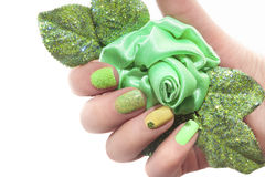 Manicure with green rose. Royalty Free Stock Photography