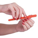 Manicure. Hand care with nail file Royalty Free Stock Image