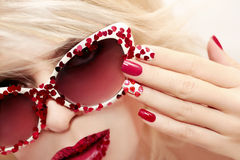 Manicure with hearts. Royalty Free Stock Image